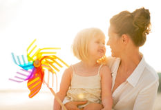 mother-baby-girl-holding-colorful-windmill-portrait-happy-toy-beach-evening-44274242
